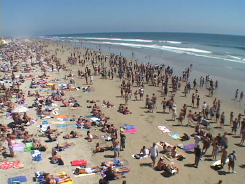 Crowds fill a Malibu beach Stock Video Footage