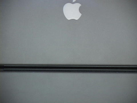 A hand closes an Apple Powerbook Stock Video Footage