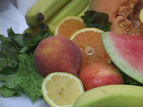 A fruit display includes watermelons and bananas Stock Video Footage