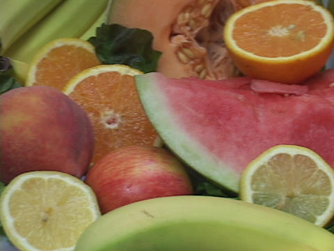 A fruit display includes watermelons and bananas Footage