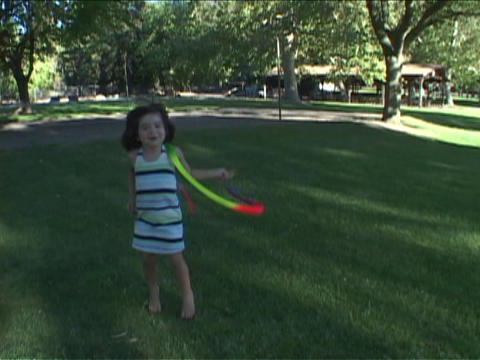 A girl twirls a streamer in her hand Stock Video Footage