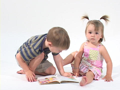 children read a book in a white room Live Action