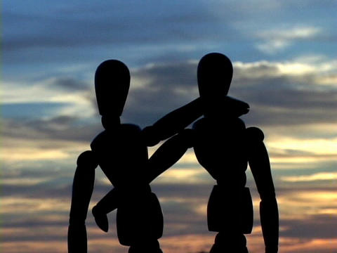 Entwined mannequins watch the clouds Stock Video Footage