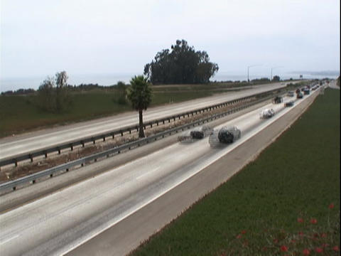 Traffic travels along a freeway Footage