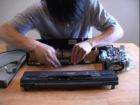 A man assembles electronic parts Stock Video Footage