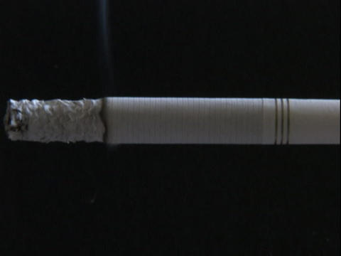The ash grows on a cigarette as it burns Stock Video Footage