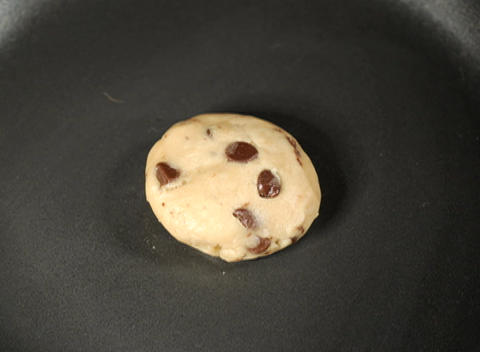 A chocolate chip cookie bakes in a oven Stock Video Footage