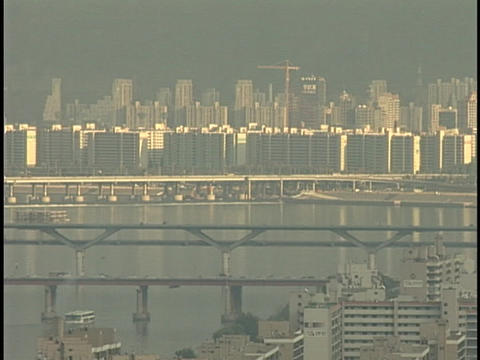 Traffic speeds across a bay over a large bridge Stock Video Footage