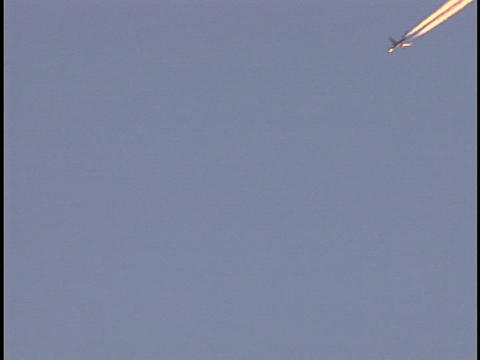 An airplane streaks across the sky Stock Video Footage