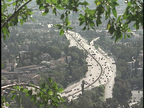Traffic drives on a freeway Stock Video Footage
