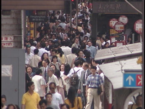 Pedestrians walk on a crowded sidewalk Stock Video Footage
