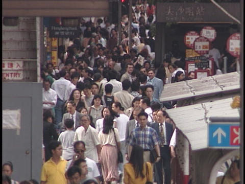 Pedestrians walk on a crowded sidewalk Footage