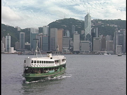 A ferry boat crosses a harbor Stock Video Footage