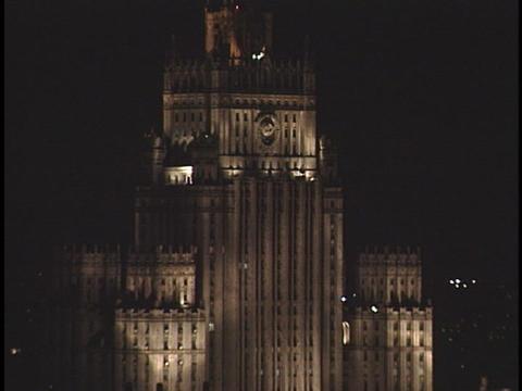 Lights illuminate the decorative towers on a skyscraper Stock Video Footage