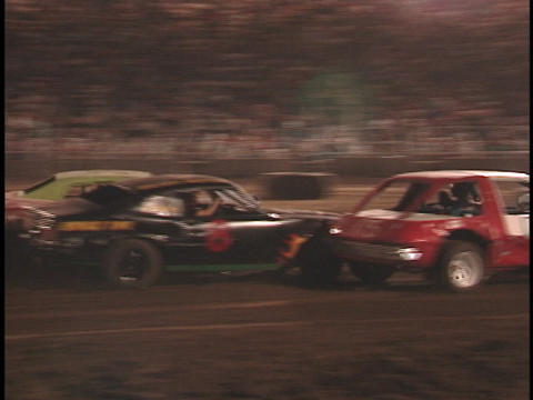 Cars smash together in a dusty demolition derby Footage