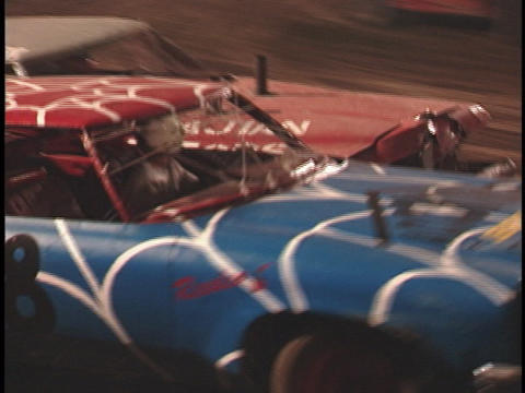 demolition cars smash into each other as they speed around a track Footage