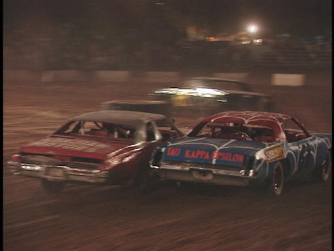 demolition cars smash into each other as they speed... Stock Video Footage