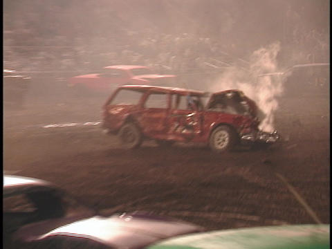 Surviving cars in a demolition derby avoid the wreckage of their fellow competitors Footage