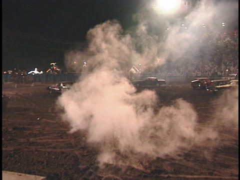 A demolition car with a smoking hood reverses to get back... Stock Video Footage