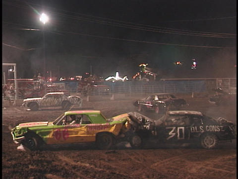 Three demolition cars crash into another Footage