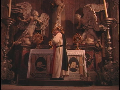 A catholic priest says a prayer in a church Stock Video Footage