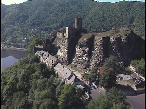 An aerial of a large castle on a mountain top Stock Video Footage