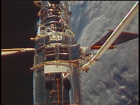 A satellite flies in orbit over the Earth Stock Video Footage