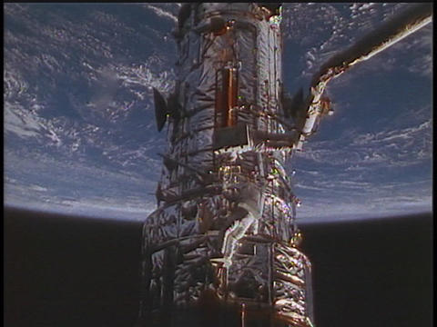 An astronaut performs a spacewalk in orbit Stock Video Footage