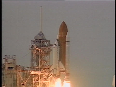 The space shuttle lifts off from the launch pad Stock Video Footage