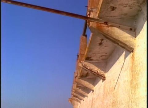 Tilt to Alcatraz prison walls to San Francisco Bay Stock Video Footage
