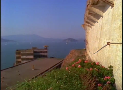 Tilt to Alcatraz prison walls to San Francisco Bay Stock Video Footage