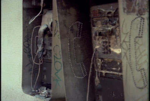 Burned out phone boxes during the LA riots in 1992 Stock Video Footage