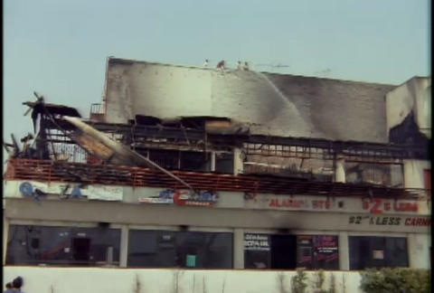 A strip mall is burned during the LA riots in 1992 Stock Video Footage