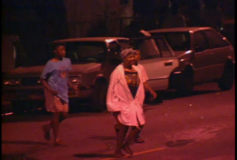 People rioting at night during the LA Riots Stock Video Footage