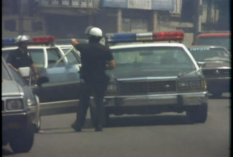Police direct traffic during the LA Riots Stock Video Footage