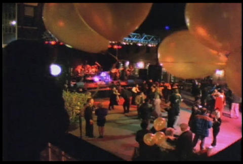People dance at an outdoor concert or disco Footage