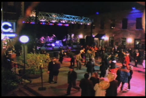 People dance at an outdoor concert or disco Stock Video Footage