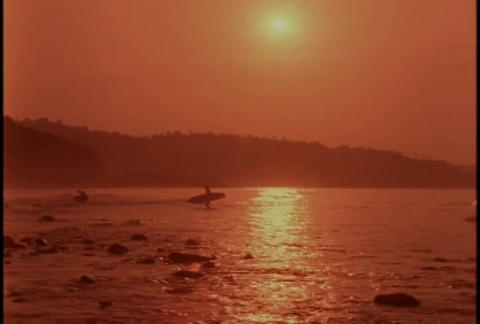 A surfer at sunset Footage