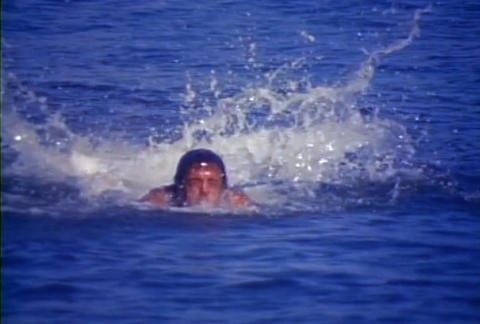 A man swims fast in the ocean Stock Video Footage