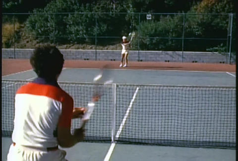 A couple plays tennis in this over the shoulder sh Stock Video Footage