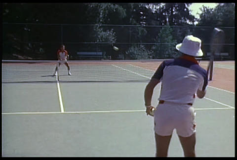 Two people play tennis Stock Video Footage