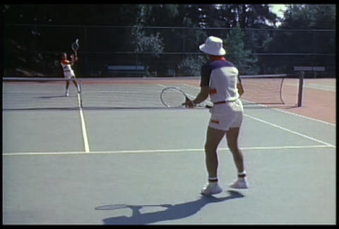 Two people play tennis Footage