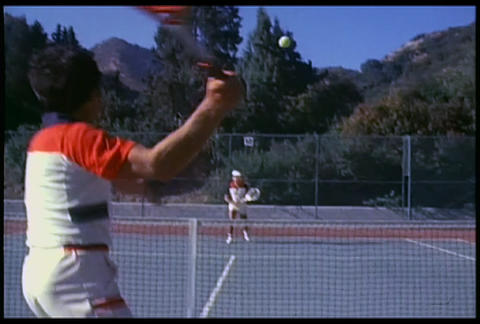 An over the shoulder shot of people playing tennis Footage
