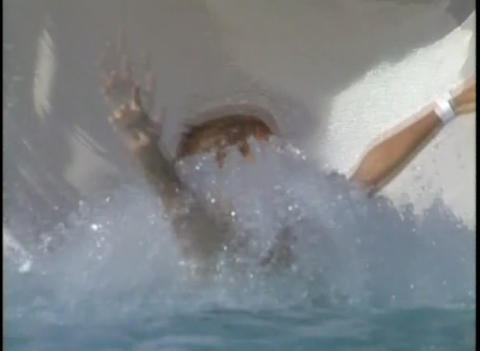 A boy goes backwards down a water slide on an inne Stock Video Footage