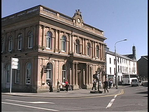 An old building adorns a street corner in Ireland Footage