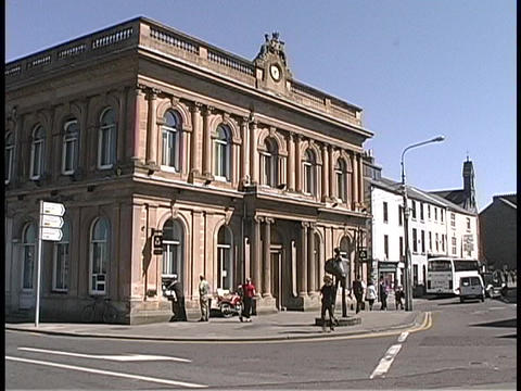 An old building adorns a street corner in Ireland Stock Video Footage