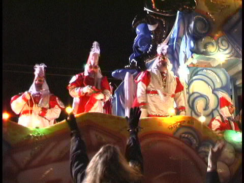 A colorful float passes by a crowd of people during a Mardi Gras parade in New Orleans Footage