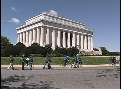 People walk and bicycle near the Lincoln Memorial in Washington DC Footage