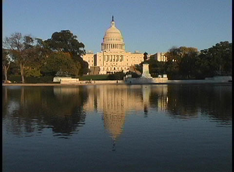 The United States Capitol reflects in a calm pool of water Footage