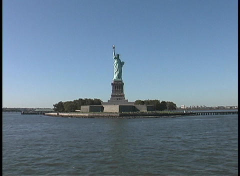 The Statue of Liberty stands in New York's harbor Stock Video Footage